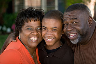 boy with parents, smiling